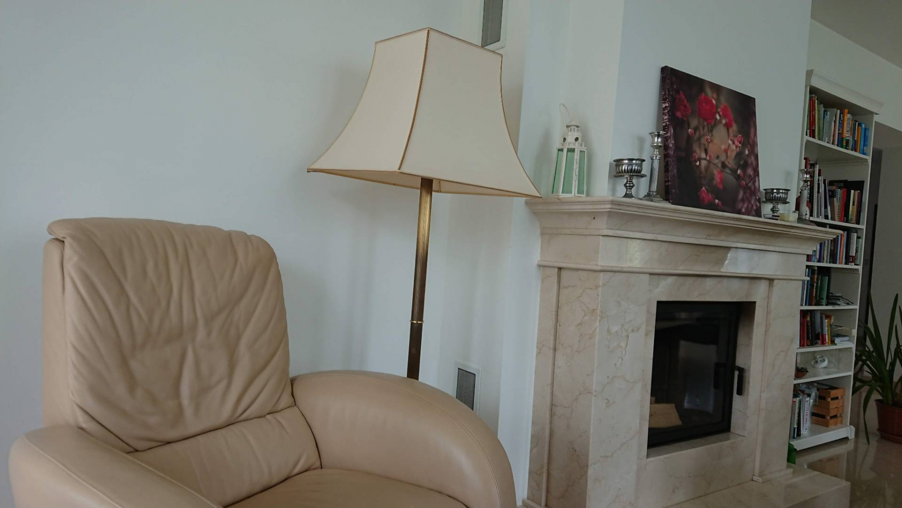 Fireplace in the living room with armchair