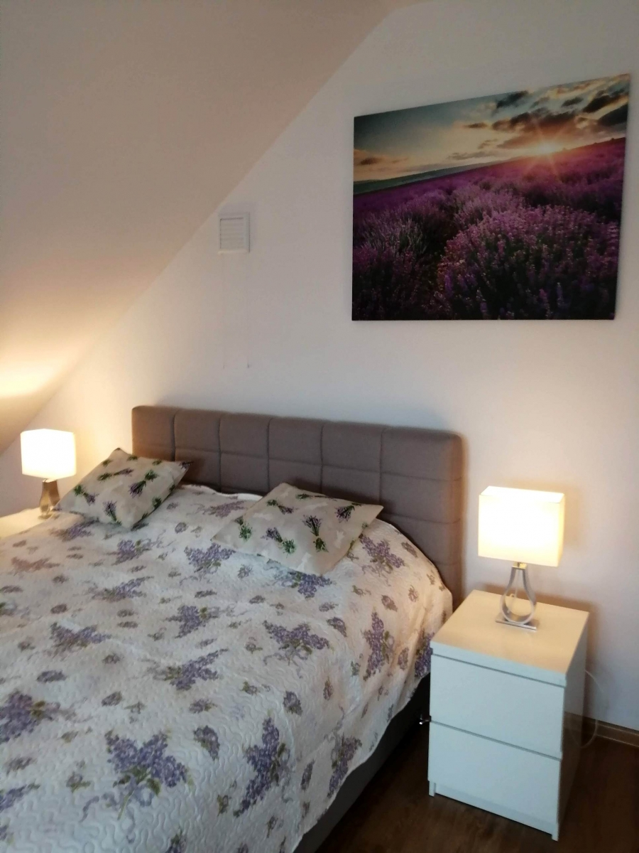 A double bed in a lavender suite